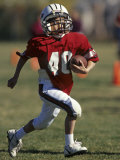 8 Year Old Boy Running with the Football Photographic Print