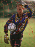 Portrait of Soccer Goalie in the Net Photographic Print