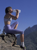 Woman Rock Climber Drinking During a Rest Break Photographic Print