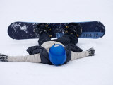 Female Snowboarder Collapsed after a Run, New York, USA Photographic Print by Paul Sutton