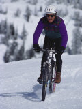Mountain Biking on Snow Photographic Print