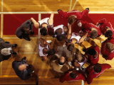 Overhead View of Coach Instructing High School Basketball Team Photographic Print