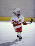 Young Ice Hockey Player in Action Fotografie-Druck
