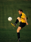 Male Soccer Player in Action Photographic Print