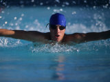 Male Swimmer Competing in Abutterfly Race Photographic Print