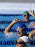 Woman Celebrating Her Victory in Swimming Race Photographic Print