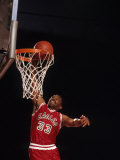 Male Basketball Player Slam Dunking a Basket Photographic Print