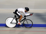 Action of Female Cyclist Competing on the Velodrome Fotografie-Druck