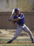 Baseball Player in Action Batting Photographic Print