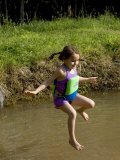 5 Year Old Girl Jumping into a Pond, Woodstock, New York, USA Photographic Print by Paul Sutton