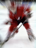Zoom Explosion View of Ice Hockey Player Photographic Print by Paul Sutton