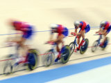 Blurred Action of Cycliing Team Onthe Track Fotografisk tryk af Chris Trotman