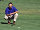 Male Golfer Lining Up a Putt Photographic Print by Chris Trotman