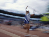 Pole Vaulter Flys over the Bar Photographic Print by Steven Sutton