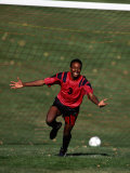 Soccer Player Celebrating after Scoring a Goal Photographic Print