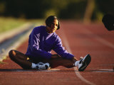 Female Runner Stretching While Training on the Track Photographic Print