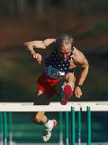 Mature Athlete Competing in Hurdles Race, Atlanta, Georgia, USA Photographic Print by Paul Sutton