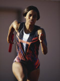 Female Runner Competing in a Track Race Photographic Print