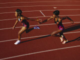 Female Runner Competing in a Relay Track Race Reproduction photographique