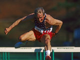 Mature Athlete Competes in Hurdles Race, Atlanta, Georgia, USA Photographic Print by Paul Sutton