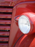 Headlight and Partial Grill of a Red Antique Truck Photographic Print by Kathleen Clemons
