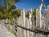 Fenceline Built Along Sidewalk, San Felipe, Yucatan, Mexico Photographic Print by Julie Eggers