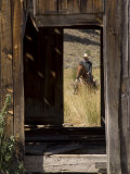 Cowboy Through a Weathered Door, Ponderosa Ranch, Seneca, Oregon, USA Photographic Print by Wendy Kaveney