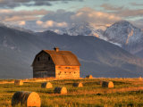 Old Barn Framed By Hay Bales, Mission Mountain Range, Montana, USA Photographic Print by Chuck Haney