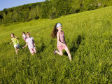 Young girls running in field, Sabins Pasture, Montpelier, Vermont, USA Photographic Print by Jerry & Marcy Monkman