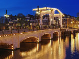 Dusk view of Magere Brug or Skinny Bridge and Amstel River, Netherlands, Holland Photographic Print by Adam Jones