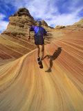 Trail Runner on Sandstone, Coyote Buttes, Utah, USA Photographic Print by Chuck Haney