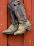 Worn Cowboy Boots Hanging, Ponderosa Ranch, Seneca, Oregon, USA Photographic Print by Wendy Kaveney