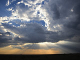 Sunbeams Streaming through Clouds, Masai Mara Game Reserve, Kenya Photographic Print by Adam Jones