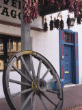 Antique wagon wheel, Old Town Albuquerque, New Mexico Photographic Print by Jerry Ginsberg