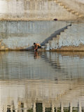 Indian man washing himself, Udaipur, India Photographic Print by Adam Jones