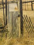 Old Door in Homestead Fence, Montana, USA Fotografie-Druck von Nancy Rotenberg