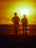 Jogging at Sunset Photographic Print by Douglas Peebles