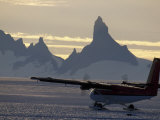 Ski-Equipped Twin Otter Takes Off from an Ice Runway Photographic Print by Gordon Wiltsie