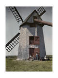 Kids Play around an Old Corn Mill in Nantucket Photographic Print by Clifton R. Adams