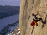 Rock Climber Ascends a Rope on the North Face of Great Sail Peak Photographic Print by Gordon Wiltsie