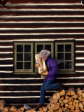 Woman Collecting Fire Wood by a Log Cabin Photographic Print by Kate Thompson