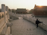 At Dawn, a Man Stretches Below the Temple of Heaven Photographic Print by Gordon Wiltsie