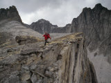 Mountaineer Runs Atop a Cliff in the Cirque of the Unclimbables Photographic Print by Gordon Wiltsie