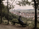 Woman Sits Atop a Hill Overlooking the Rooftops of the Kassel Town Photographic Print by Wilhelm Tobien