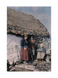 Three Generations of Peasant Women Stand Outside their Stone Cottage Photographic Print by Clifton R. Adams