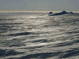 Wind-Sculpted Sastrugi on Polar Plateau Circles Three Sails Nunataks Photographic Print by Gordon Wiltsie
