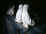 Young Muslim Girls Covered Head to Toe in Traditional Muslim Clothing Photographic Print by  xPacifica