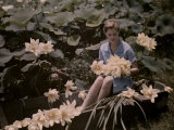 Woman Sits in a Boat Among the Lotuses,A Common Louisiana Flower Photographic Print by Edwin L. Wisherd