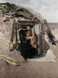 Girl Stands in Front of Her Hut on the Painted Desert Photographic Print by Clifton R. Adams