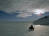 Explorer Drives an Atv across a Shimmering Bare Ice Glacier Photographic Print by Gordon Wiltsie
